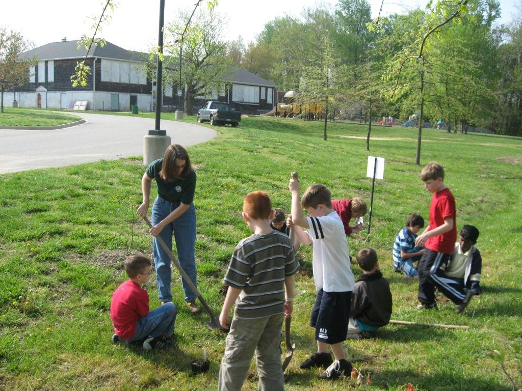 Kennard School children planting a rain garden